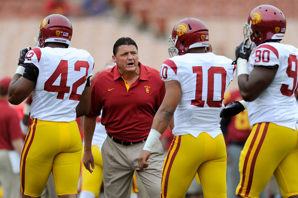 . Defensive line coach Ed Orgeron talks to his players at  USC\'s Spring Football Game. (Michael Owen Baker/Staff Photographer)