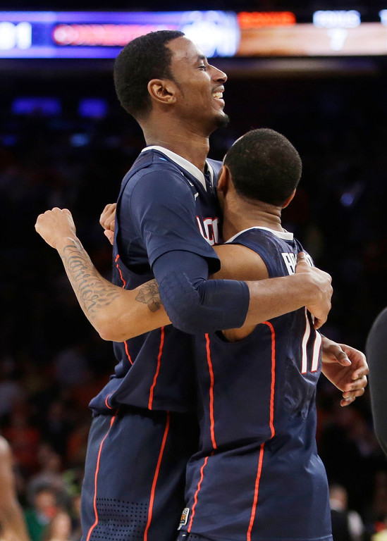 . Connecticut\'s DeAndre Daniels, left, hugs teammate Ryan Boatright after Connecticut defeated Iowa State 81-76 in a regional semifinal of the NCAA men\'s college basketball tournament Friday, March 28, 2014, in New York. (AP Photo/Frank Franklin II)