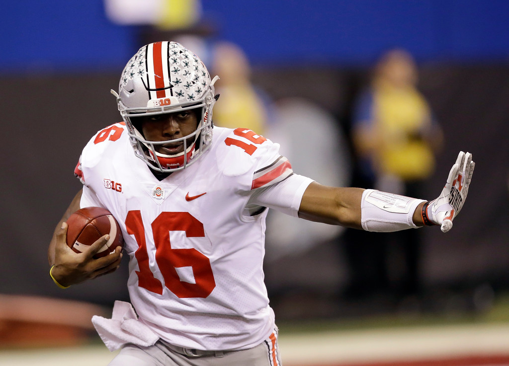 . Ohio State quarterback J.T. Barrett runs with the ball during the first half the Big Ten championship NCAA college football game against Wisconsin, Saturday, Dec. 2, 2017, in Indianapolis. (AP Photo/AJ Mast)