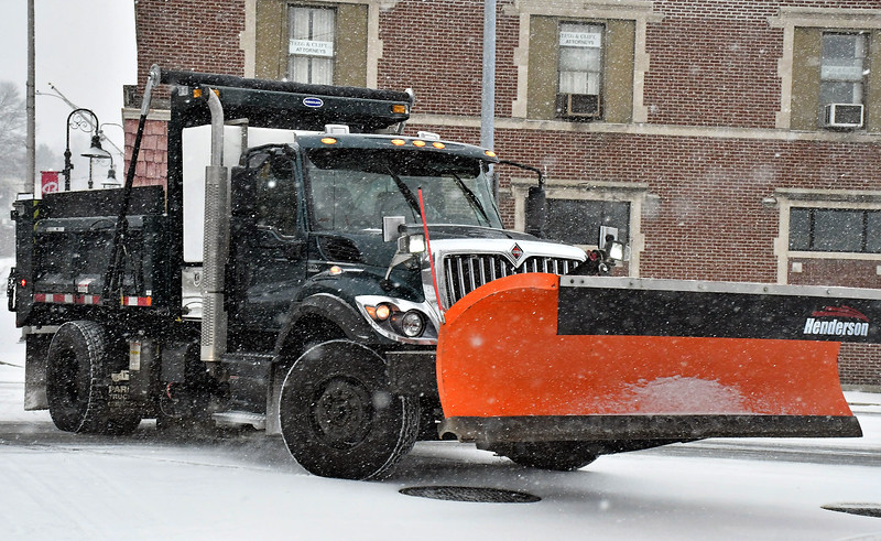 1/18/2020 Mike Orazzi | Staff A city of Bristol snowplow out during Saturday's snow storm on Memorial Blvd.