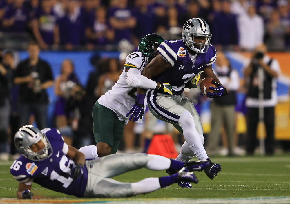 . Chris Harper #3 of the Kansas State Wildcats tries to break the tackle of Terrance Mitchell #27 of the Oregon Ducks after an eight yard reception in the first quarter of the Tostitos Fiesta Bowl at University of Phoenix Stadium on January 3, 2013 in Glendale, Arizona.  (Photo by Doug Pensinger/Getty Images)