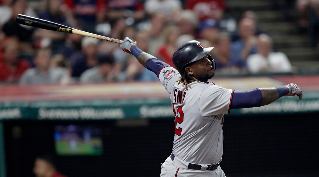 . Minnesota Twins\' Miguel Sano watches his solo home run during the ninth inning of a baseball game against the Cleveland Indians, Wednesday, Aug. 8, 2018, in Cleveland. The Indians won 5-2. (AP Photo/Tony Dejak)