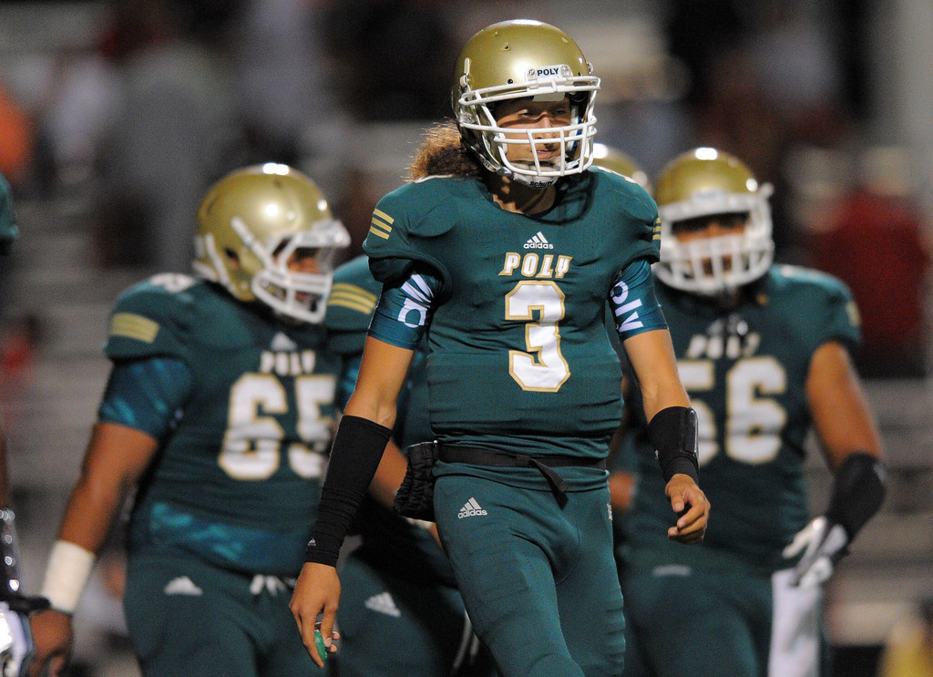 . Long Beach Poly football takes on Centennial (Corona) as part of the Mission Viejo Classic in Mission Viejo, CA on Friday, September 13, 2013. Poly QB Tai Tiedemann walks off the field after being stopped by the Centennial defense. (Photo by Scott Varley, Press-Telegram)