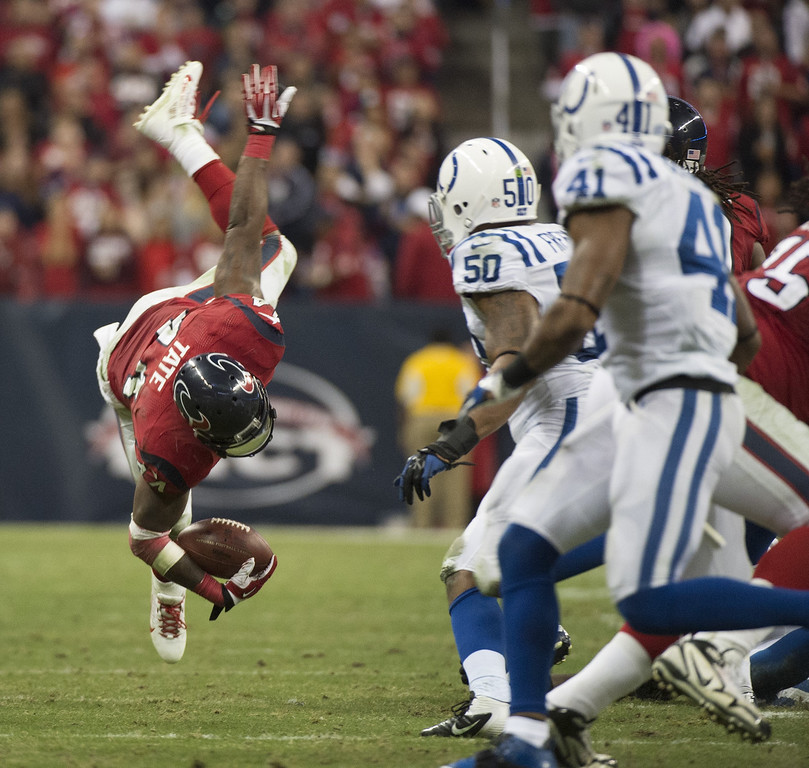 . Running back Ben Tate (44) of the Houston Texans is upended on a run against the Indianapolis Colts in the second half of the Colts\' 27-24 victory on Sunday, November 3, 2013, in Houston, Texas. (George Bridges/MCT)