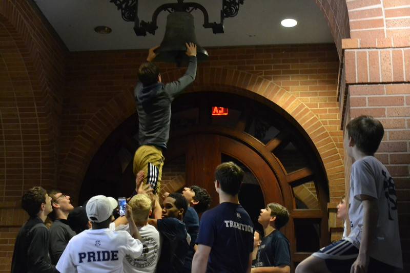 Cole Clement rings the bell.JPG