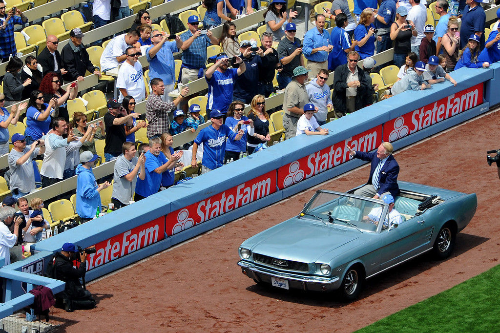 . Dodger announcer Vin Scully comes onto the field in a Mustang at the Dodgers home opener, Friday, April 4, 2014, at Dodger Stadium. (Photo by Michael Owen Baker/L.A. Daily News)
