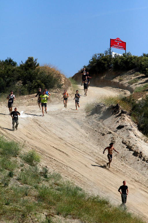 . Runners make their way downhill during the Sheriff�s Athletic Federation\'s annual 5K Mud Run on Saturday, May 17, 2014 at the Sheriff�s Department Academy in Devore, Ca. (Photo by Micah Escamilla/San Bernardino Sun)
