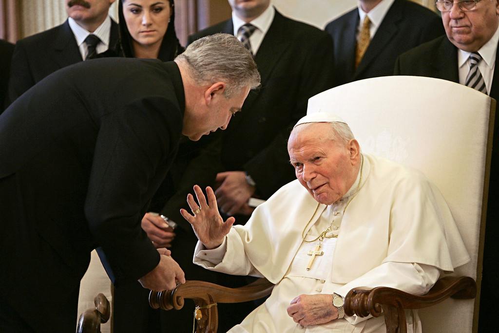 . Pope John Paul II greets Croatian Prime Minister Ivo Sanader, left, during a private audience at the Vatican, Tuesday, Feb. 22, 2005. Prime Minister Sanader was the first foreign leader to meet with the pontiff since he was  rushed to the hospital with breathing problems three weeks ago. (AP Photo/Pool, Tony Gentile)