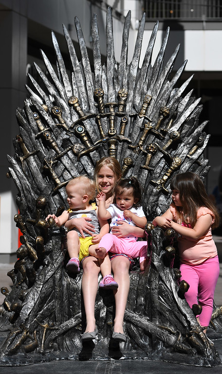 """. DENVER, CO - APRIL 22: Left to right, Lucy Ward, 1, Elizabeth Scaff, 9, Brooklyn, 1, and Izabelle, Hernandez, 3. The famous seat that characters are battling for in HBO\'s smash hit \""""Game of Thrones\"""" is now on display in the Denver Pavilions in downtown Denver for fans to pose and take pictures with for free leading up to the premiere of the show\'s sixth season on Sunday. (Photo by Kathryn Scott Osler/The Denver Post)"""