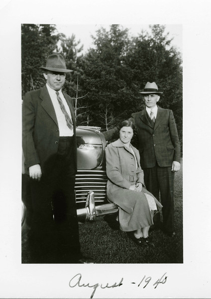 August 1940. The cars are more solid than those in the 30's and the picnics more formal. Grandpa Z to the right, perhaps his brother Max on the left, and who knows who in the middle. That ain't grandma.