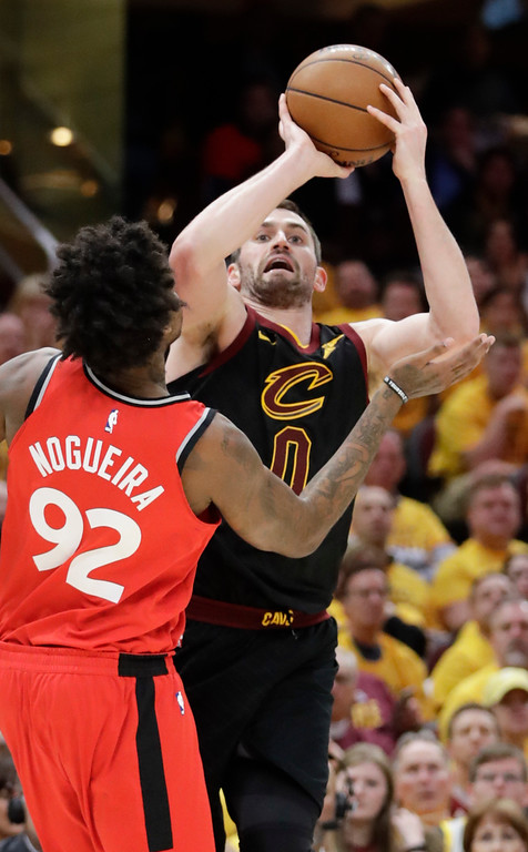 . Cleveland Cavaliers\' Kevin Love shoots over Toronto Raptors\' Lucas Nogueira (92), from Brazil, in the first half of Game 4 of an NBA basketball second-round playoff series, Monday, May 7, 2018, in Cleveland. (AP Photo/Tony Dejak)