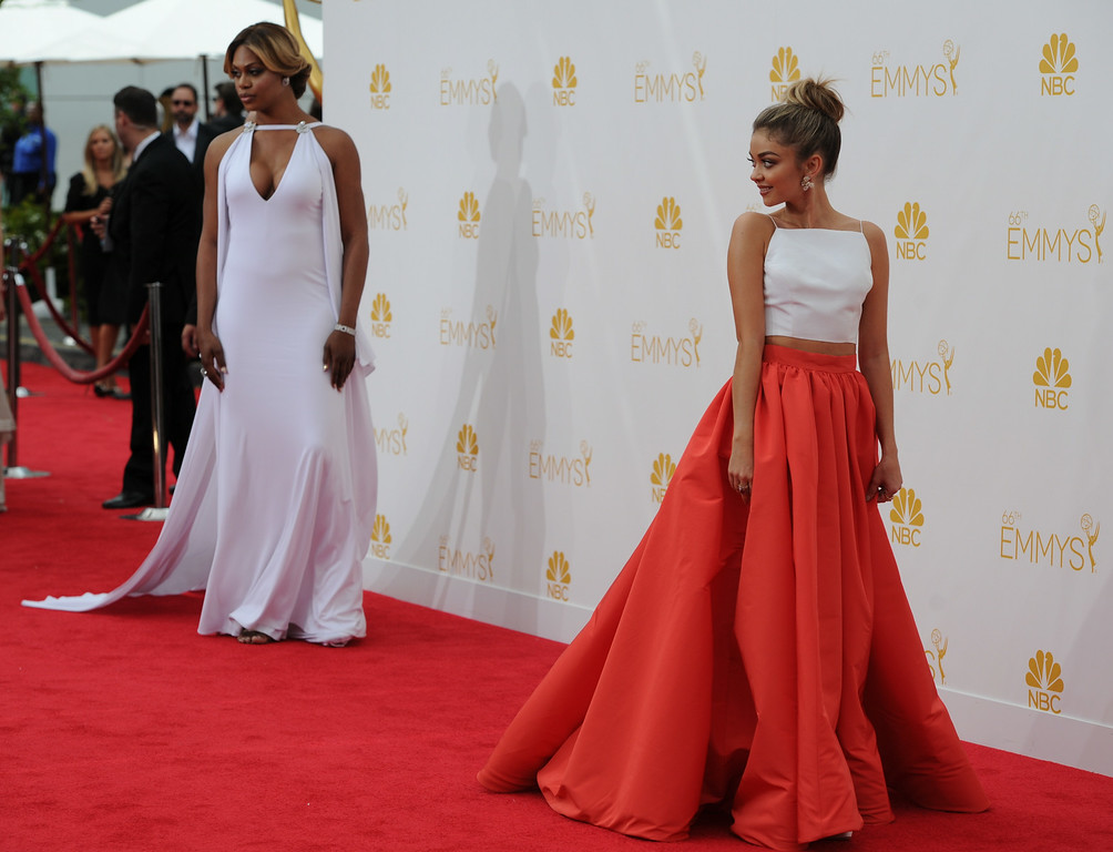 . Laverne Cox and Sarah Hyland on the red carpet at the 66th Primetime Emmy Awards show at the Nokia Theatre in Los Angeles, California on Monday August 25, 2014. (Photo by John McCoy / Los Angeles Daily News)