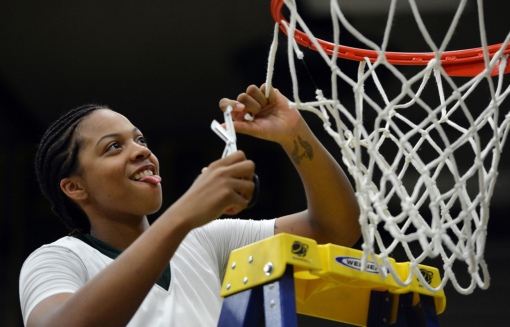 . Cal Poly Pomona\'s Ashley Lovett cuts the net after Cal Poly defeated Montana State Billings during the NCAA Division II West Regional championship game at Cal Poly Pomona in Pomona, CA, Monday, March 17, 2014. (Photo by Jennifer Cappuccio Maher/Inland Valley Daily Bulletin)