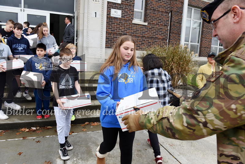 Harold Aughton/Butler Eagle: Butler Middle Schoolers carry care packages to a truck to be delivered to soldiers serving abroad.
