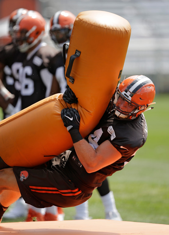 . Cleveland Browns defensive end Carl Nassib hits a tackling pad during practice at the NFL football team\'s training camp facility, Thursday, July 27, 2017, in Berea, Ohio. (AP Photo/Tony Dejak)