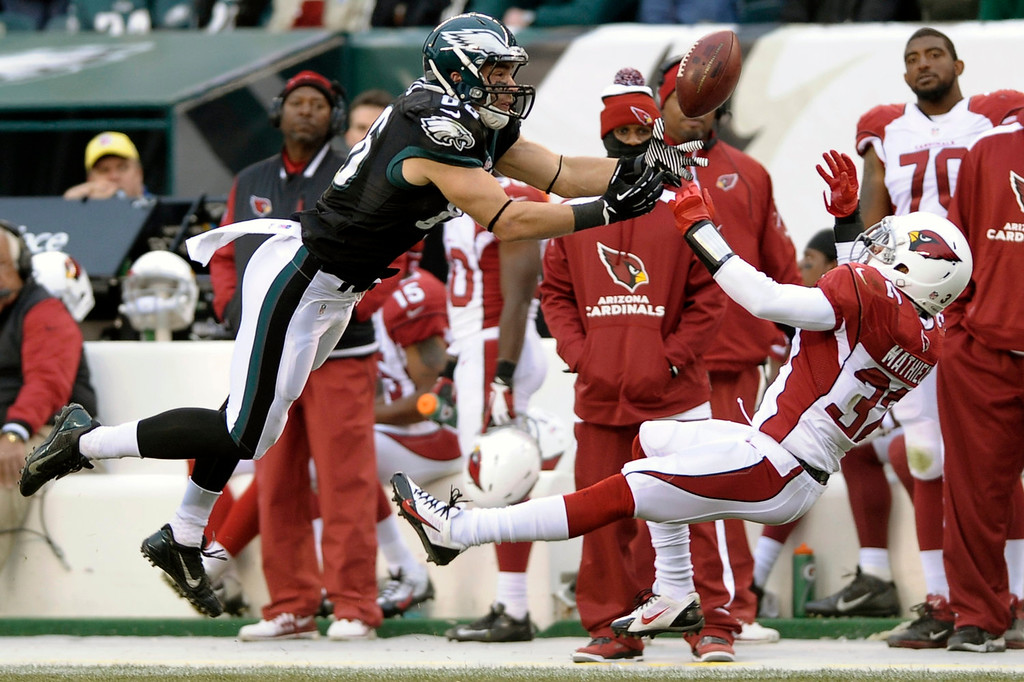 . Philadelphia Eagles\' Zach Ertz, left, is unable to pull in a pass against Arizona Cardinals\' Tyrann Mathieu during the second half of an NFL football game, Sunday, Dec. 1, 2013, in Philadelphia. (AP Photo/Michael Perez)