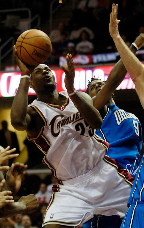 . Ken Blaze/KBlaze@News-Herald.com LeBron James drives to the basket past Orlando\'s DeShawn Stevenson Tuesday at the Q.