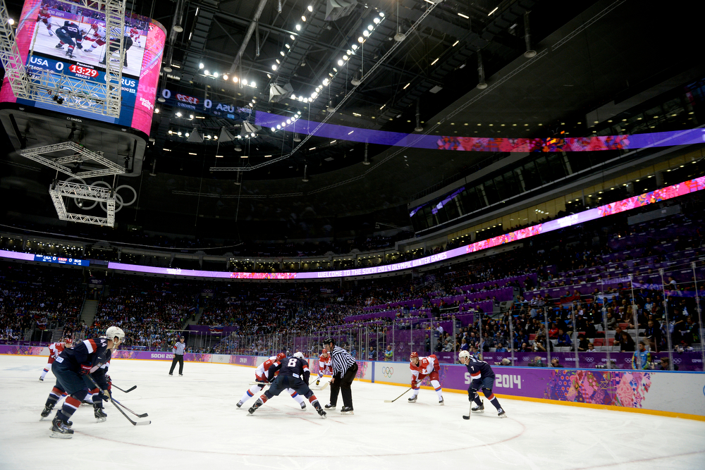 . Yevgeni Malkin (11) of the Russia and Joe Pavelski (8) of the U.S.A. face off during the second period of men\'s hockey action at Bolshoy arena. Sochi 2014 Winter Olympics on Saturday, February 15, 2014. (Photo by AAron Ontiveroz/The Denver Post)