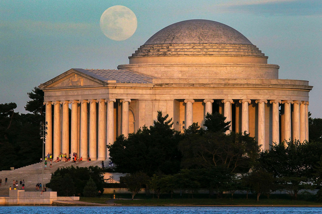 ". A full moon rises behind the Jefferson Memorial in Washington D.C. on Saturday, June 22, 2013. The larger than normal moon called a ""super moon\"" happens only once this year as the moon on its elliptical orbit is at its closest point to Earth.  (AP Photo/J. David Ake)"