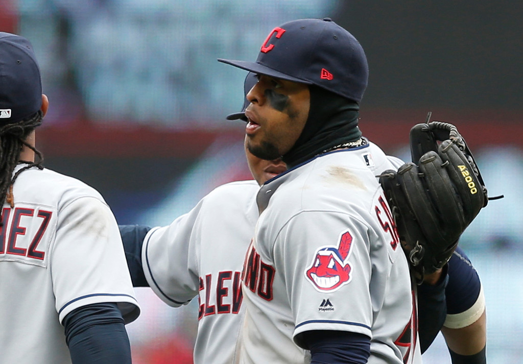 . Cleveland Indians\' players including Carlos Santana, right, celebrate their 6-2 win over the Minnesota Twins in a baseball game Thursday, April 20, 2017, in Minneapolis. Santana had two RBI\'s in the game. (AP Photo/Jim Mone)