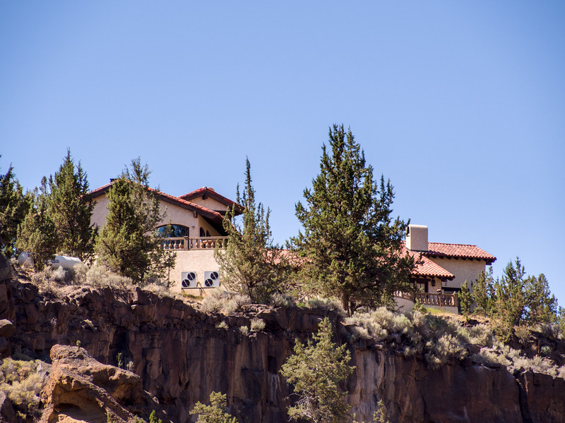 Cliff top house overlooking the park from the other side of the river