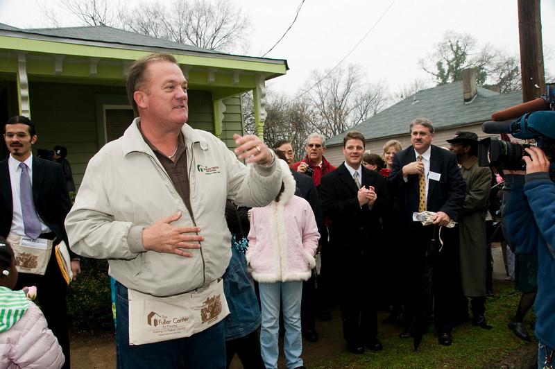 Mark Galey, president of Greater Fuller Center Atlanta, explains the renovation of the Scott family home on Fitzgerald Street. sh