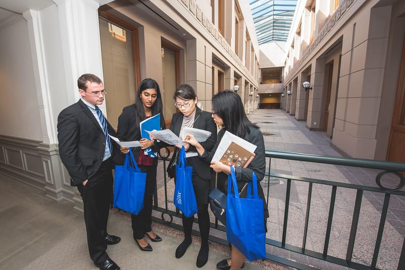 Reed Horton, Saumya Thomas, Charoenrat Kaewmanorom, and Tran Tran look at a map of the Texas Capitol as they make their way through the building.