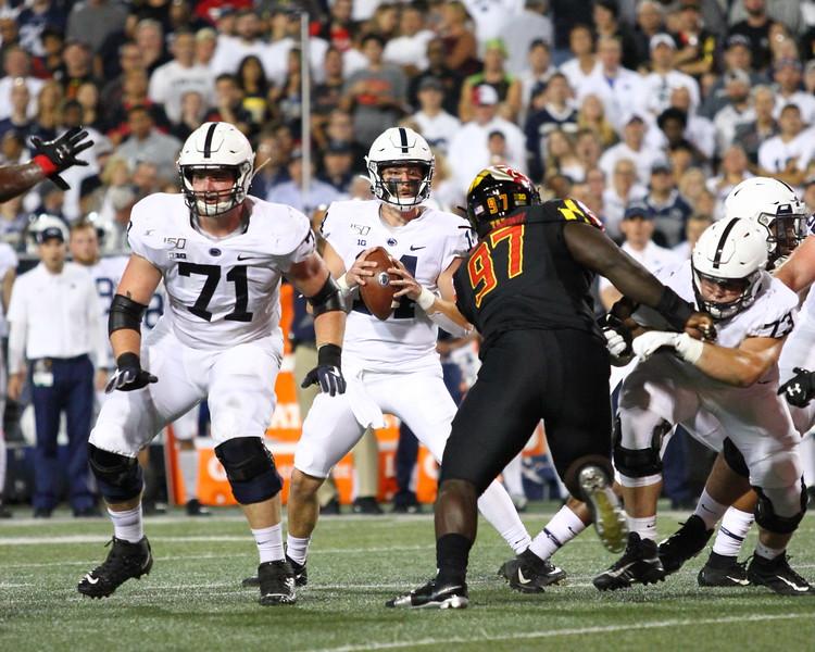 Maryland DT #97 Sam Okuayinonu pressures Penn State QB #14 Sean Clifford