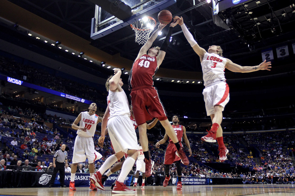 . Hugh Greenwood #3 of the New Mexico Lobos blocks John Gage #40 of the Stanford Cardinal in the first half during the second round of the 2014 NCAA Men\'s Basketball Tournament at Scottrade Center on March 21, 2014 in St Louis, Missouri.  (Photo by Andy Lyons/Getty Images)