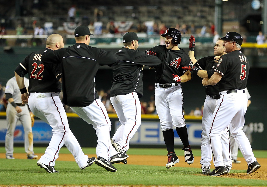 . Cody Ross #7 (third from right) of the Arizona Diamondbacks celebrates with teammates after hitting a walk off sacrifice fly to defeat the Colorado Rockies 3-2 in the 10th inning of the MLB game at Chase Field on April 27, 2013 in Phoenix, Arizona.  (Photo by Christian Petersen/Getty Images)
