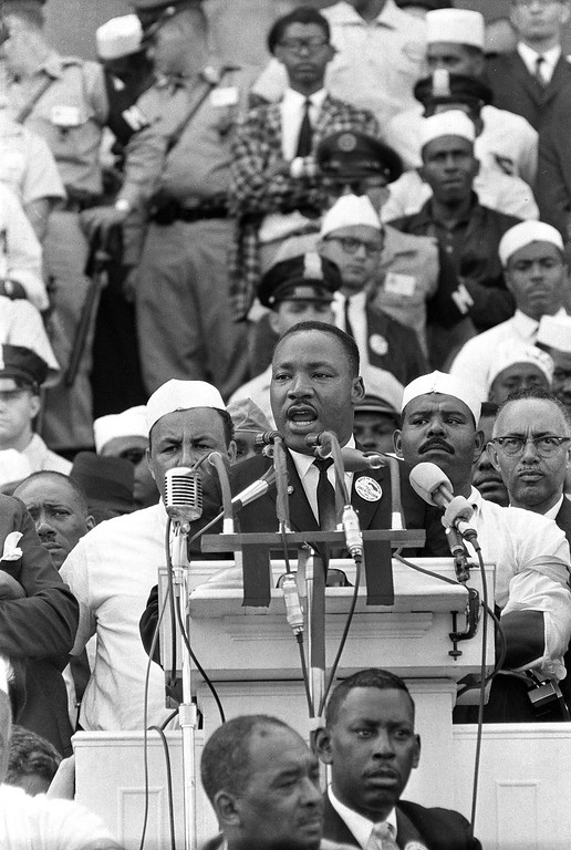 ". 1963: Martin Luther King Jr. The Rev. Dr. Martin Luther King Jr., head of the Southern Christian Leadership Conference, gestures during his ""I Have a Dream\"" speech as he addresses thousands of civil rights supporters gathered in Washington in August 1963. (AP Photo)"