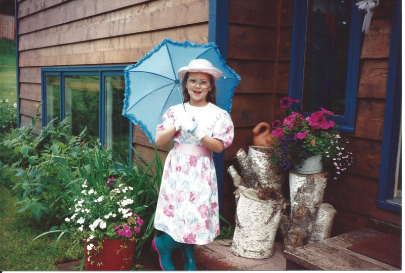 Devon going to a tea party in the rain.jpeg