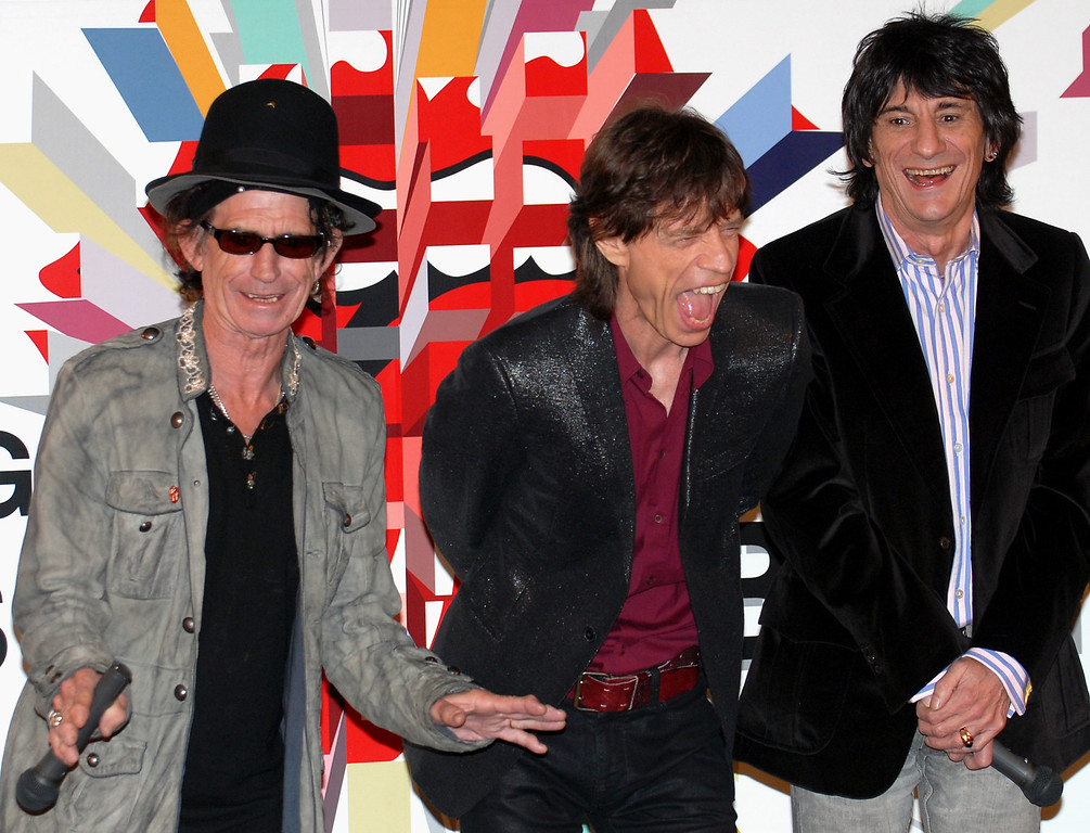 ". Members of The Rolling Stones, from left, Keith Richards, Mick Jagger and Ron Wood crack up for a joke during a press conference in Tokyo Monday, March 20, 2006. The rock \'n\' roll band will perform five concerts in Japan as part of their ""A Bigger Bang\"" world tour. (AP Photo/Katsumi Kasahara)"
