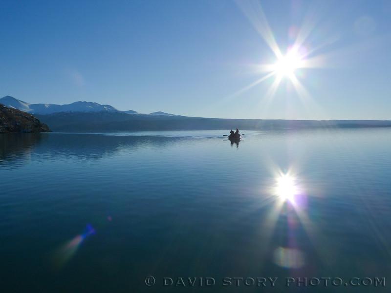 Fishermen motor across Skilak Lake.