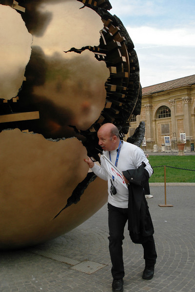 Globe and Guide at the Vatican Museum.jpg
