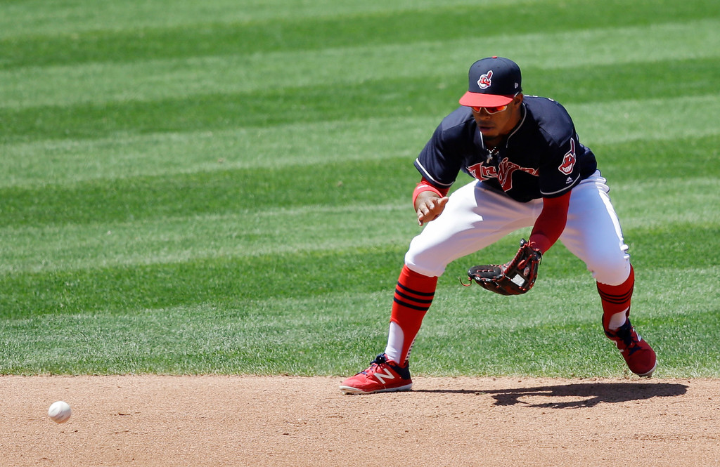. Cleveland Indians\' Francisco Lindor fields a ball hit by Chicago White Sox\'s Avisail Garcia in the fourth inning of a baseball game, Sunday, June 11, 2017, in Cleveland. Avisail was out on the play. (AP Photo/Tony Dejak)