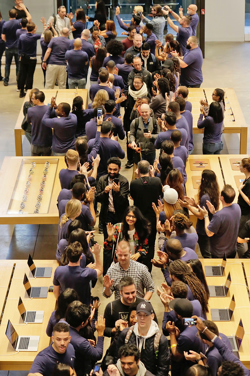 . Customers are greeted by Apple employees as they enter the Apple Store on New York\'s Fifth Avenue, to get their iPhone X, Friday, Nov. 3, 2017. (AP Photo/Richard Drew)