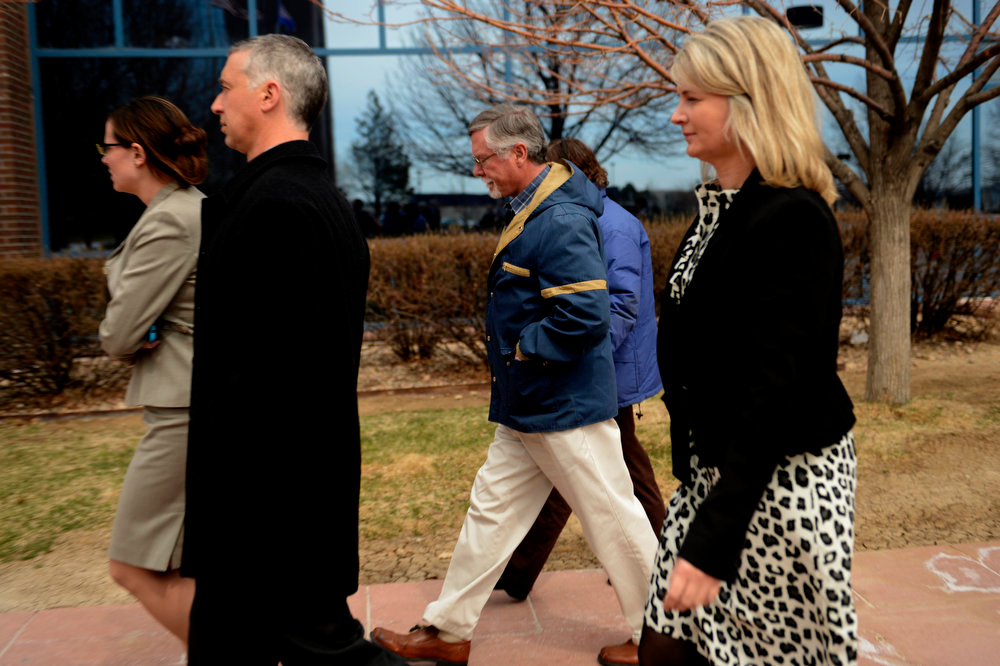 Description of . Robert and Arlene Holmes, parents of Aurora theater shooting suspect James Holmes, (center) leaving the Arapahoe County Justice Center April 01, 2013 Centennial, Colorado. (Photo By Joe Amon/The Denver Post)