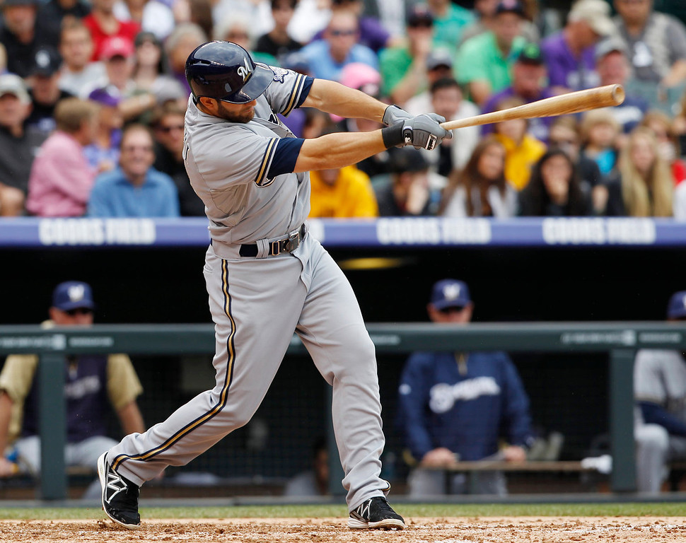 . Milwaukee Brewers\' Jeff Bianchi follows through with his swing after connecting for an RBI-single against the Colorado Rockies in the fourth inning of a baseball game in Denver, Sunday, July 28, 2013. (AP Photo/David Zalubowski)