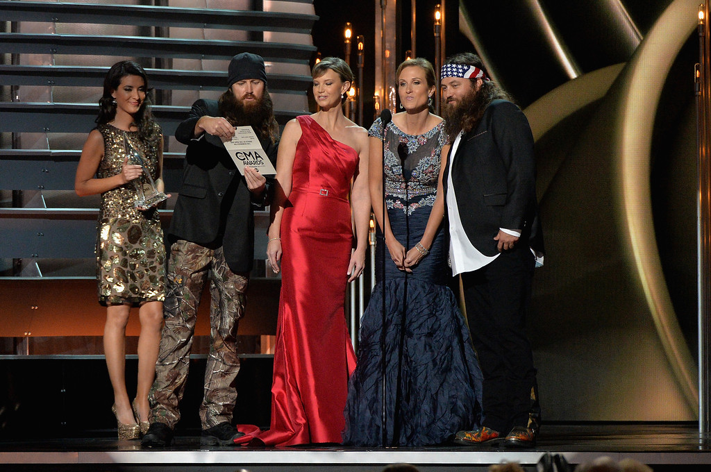 . NASHVILLE, TN - NOVEMBER 06:  The cast of Duck Dynasty speaks onstage during the 47th annual CMA Awards at the Bridgestone Arena on November 6, 2013 in Nashville, Tennessee.  (Photo by Rick Diamond/Getty Images)