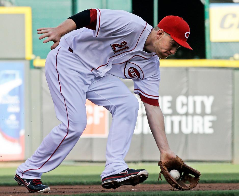 . Cincinnati Reds third baseman Todd Frazier fields a ground ball hit by Colorado Rockies\' DJ LeMahieu in the first inning of a baseball game, Tuesday, June 4, 2013, in Cincinnati. Frazier threw LeMahieu out at first. (AP Photo/Al Behrman)