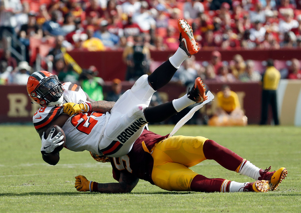 . Cleveland Browns running back Duke Johnson (29) is tackled by Washington Redskins inside linebacker Mason Foster (54) during the second half of an NFL football game Sunday, Oct. 2, 2016, in Landover, Md. (AP Photo/Carolyn Kaster)