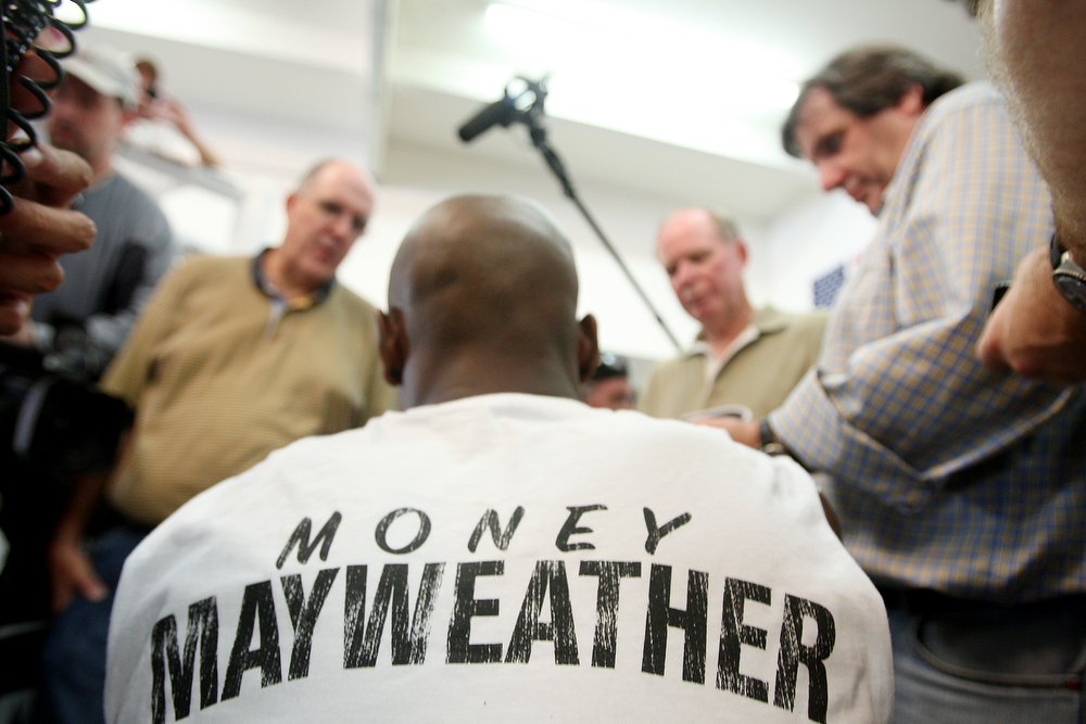 . Floyd Mayweather Jr. talks with reporters as he is taped up at his gym, Wednesday, Sept. 2, 2009 in Las Vegas. Mayweather will box Juan Manuel Marquez Sept. 19 at the MGM Grand Garden Arena. (AP Photo/Isaac Brekken)