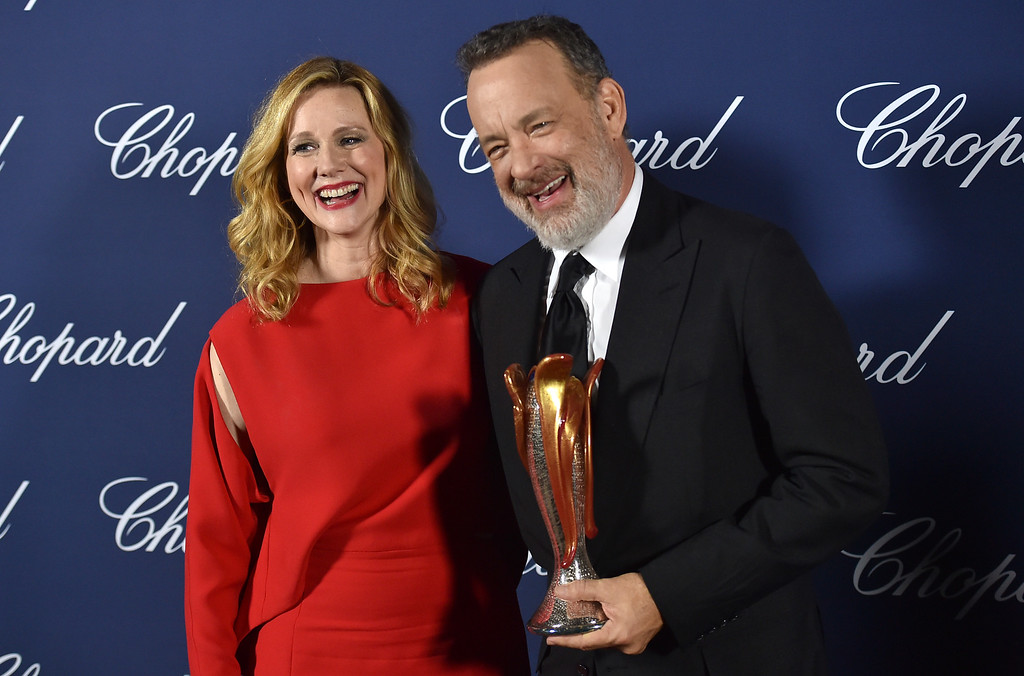 . Tom Hanks, right, winner of the Icon award, poses backstage with presenter Laura Linney at the 28th annual Palm Springs International Film Festival Awards Gala on Monday, Jan. 2, 2017, in Palm Springs, Calif. (Photo by Chris Pizzello/Invision/AP)
