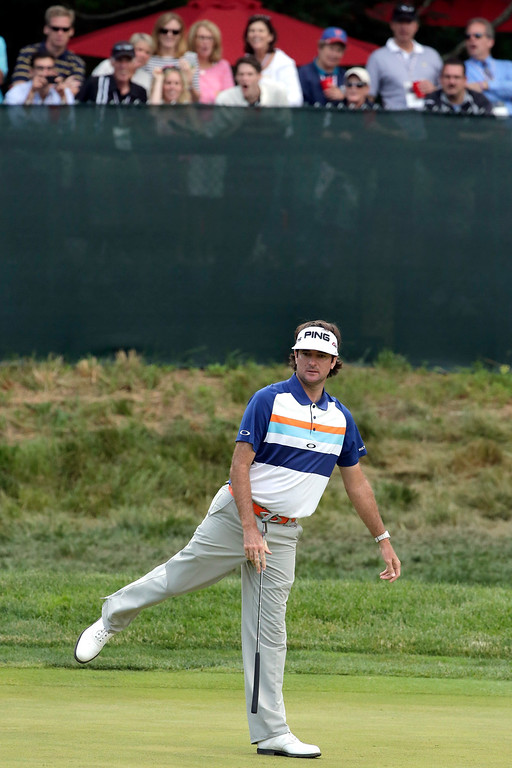 . Bubba Watson reacts to a missed putt on the sixth green during the second round of the U.S. Open golf tournament at Merion Golf Club, Friday, June 14, 2013, in Ardmore, Pa. (AP Photo/Charlie Riedel)