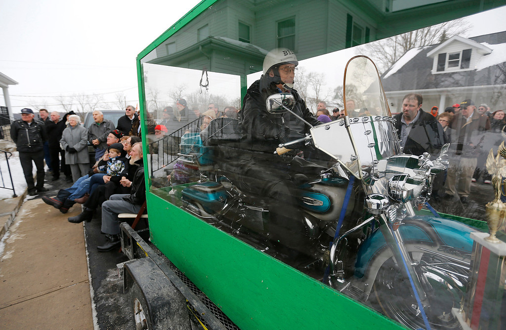 . The body of Bill Standley secured to his 1967 Harley Davidson rests inside a plexiglass box during his funeral service in Mechanicsburg, Ohio on Friday, Jan. 31, 2014.   (AP Photo/Columbus Dispatch, Jonathan Quilter)