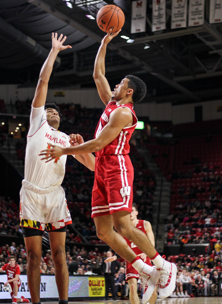 January 14, 2019: Wisconsin guard D'Mitrik Trice (0) shoots over Maryland forward Ricky Lindo Jr (14) during BIG Ten Men Basketball action between University of Wisconsin and University of Maryland in College Park. Photo by: Chris Thompkins/Prince Georges Sentinel