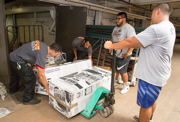 07/11/19 Wesley Bunnell | Staff Tyler Ounthongdy, R, Ronnie Palma, 2nd R, both NB Parks and Rec employees, get ready to haul away a pallet of toy cars inside of a warehouse at 1 Hartford Square on Thursday morning. Approximately 300 toy cars were donated and delivered by Fisher-Price on to expand the Go Baby Go! program which is a learning project between New Britain High School and CCSU students in the technology fields. The program helps children with limited mobility by modifying toy cars for the exact needs of each child.