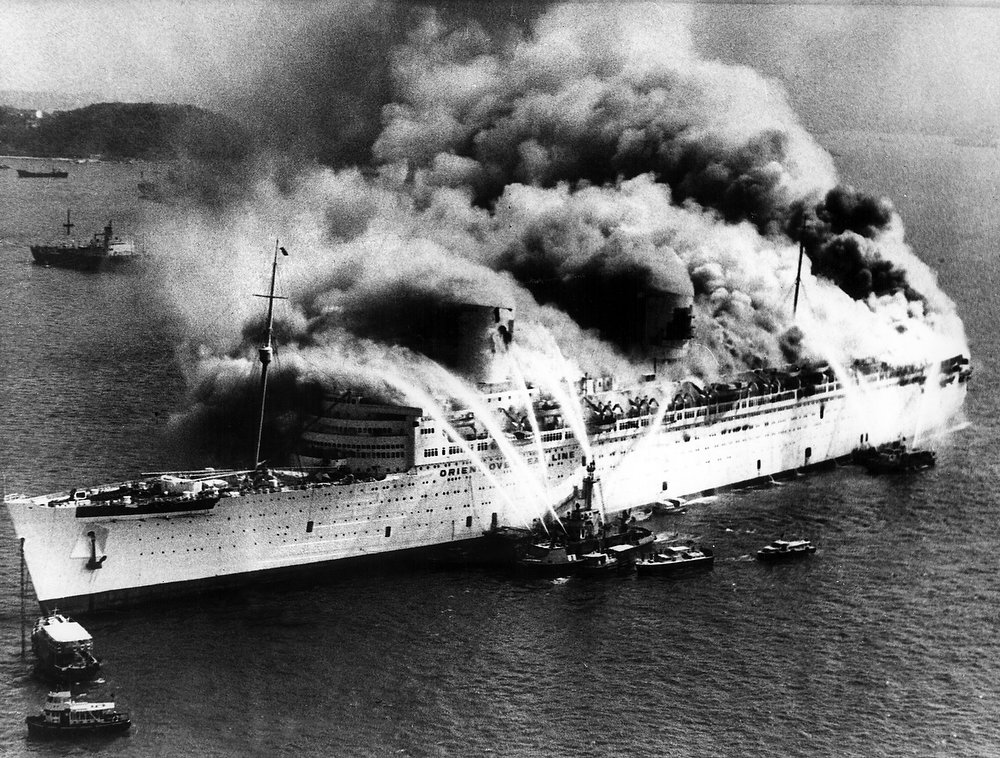 Description of . Fireboats spray water in vain on the blazing former luxury liner Queen Elizabeth in Hong Kong Harbor on Sunday Jan. 9th, 1972. (AP Photo)