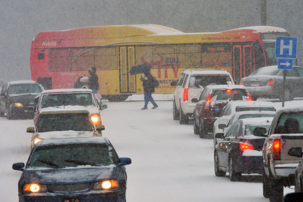 . Traffic is snarled and stopped along Main Street, near Anderson Street, as motorists and pedestrians attempt to get home during a winter storm Wednesday Feb. 12, 2014, in Durham, N.C. (AP Photo/The News & Observer, Chuck Liddy)
